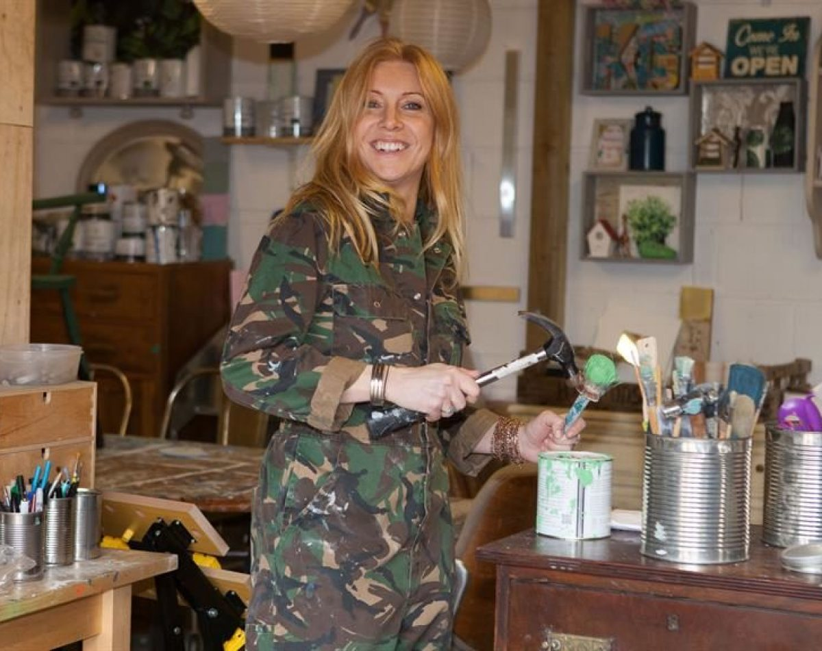 Lynne laughing in camo